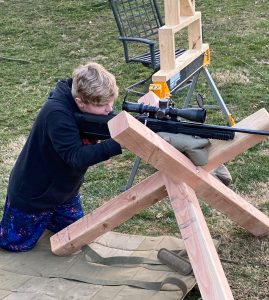 Boy practicing his shooting with a 22LR and TORIC 4-20x50 MRAD PRS